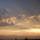 Как то вечерком мы вышли с мужем на балкон мы прожива по ул. Кузьмина 10 г. Кушва и увидели красивый пейзаж: небо было  таким красивым и не обычным  как белые пушистые облака плыли по нежному небу, а  сквозь  тучек выглядывало солнышко как будто оно где то так  близко, а самого его невидно, только видно его яркие лучики.  Это так было  очень  красиво и не обычно. Просто нет слов!!! Вот и решили оставить на память это пейзаж!!! © сергей и юля